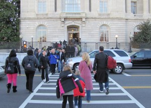 Constituents Line Up For  Access to the Cannon House Office Building to Pick Up Inaugural Tickets from Members