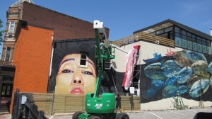 Artists Gaia and Nanook at Work on Barracks Row Mural