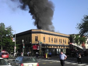 Early photo of the fire showing people still in front of the store