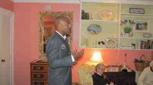 Thompson addresses residents in the Eastern Market neighborhood
