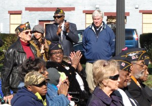 Neighbor and former Post Commander Leonard Hacker (left rear) participated in the event