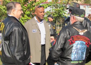 Ward Six City Council candidate Darrel Thompson talks to veterans