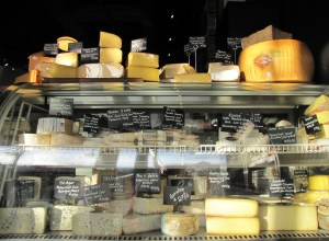 An assortment of cheeses welcomes customers as they enter.
