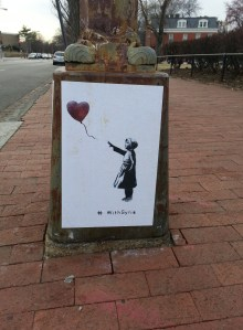 Last week, posters created by elusive graffiti artist Banksy, began appearing on Capitol Hill.  The posters created to show solidarity with the rebels against the Syrian government, commemorate the third anniversary of the beginning of the Syrian conflict – March 15, 2011.