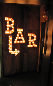 Electric Lights Point the Way to the Elixer Bar on the Lower Lever