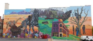 A Mural the Width of a City Block on Main Street in Pueblo References the Devastation of the 1921 Flood, the Town's Former Importance as a Saddle Manufacturing Center, and Its Latino Heritage.