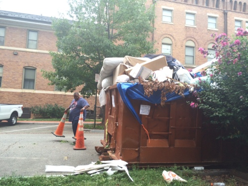 City Workers Clean Up Overflowing Dumpster behind Marine Barracks on 9th Street, SE