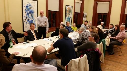Sean Ruppert (standing) of Opal LLC, hosts meeting on development of E Street Residential Project