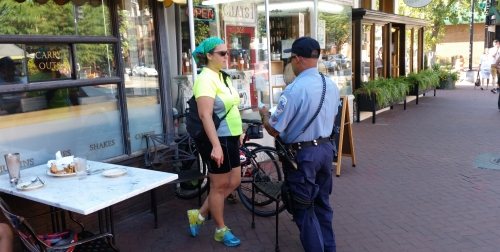 Officer G.L. Brown listens as a Brookland resident describes the attempted bike theft. The bikes were leaning against the table in the photo while the owner sat at the table.