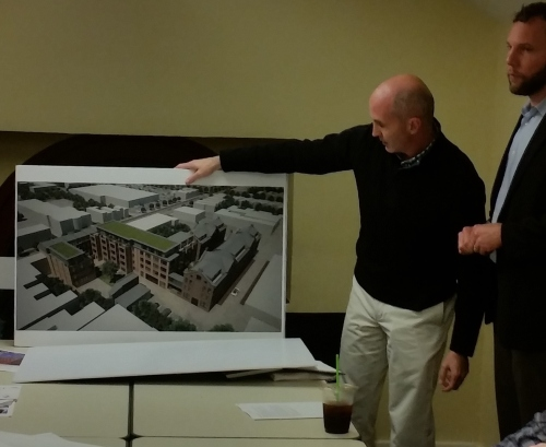 Sean Ruppert of Opal LLC, hold depiction of aerial view of Watkins Alley looking Northeast.  The large white structure at the top of the rendering is Safeway.  The white structure just below it is Frager's.