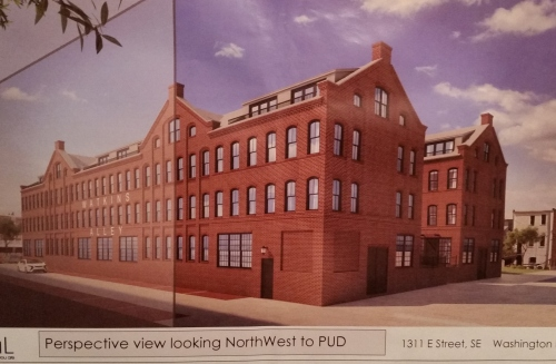 View of Watkins Alley looking north west, showing the entrance to the north courtyard.  The rendering does not show the parking lot for Signature Collision Center which would be on the right of the image.  That parcel is scheduled for development of residential units by Insight Development, who is also developing Buchanan School across the street.