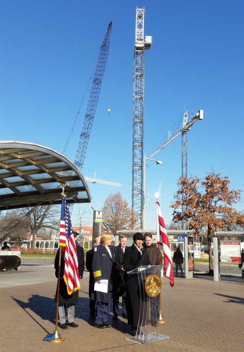 The Mayor's introductory remarks were followed by city officials explaining the work of the new Robbery Intervention Task Force.  The cranes in the background are on the Hine Development constructions site.