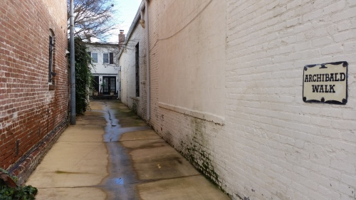The entrance to Archibald Walk invites passerby to glimpse into a residential alley and part of Washington's past