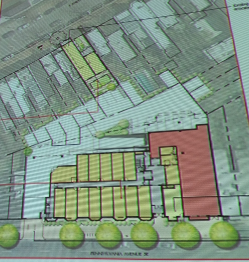 The site plan. The 5,000 retail space is indicated in red. The adjacent yellow area is the site of the bulk of the mixed use project. The Shotgun House site in in yellow near the top of the image.