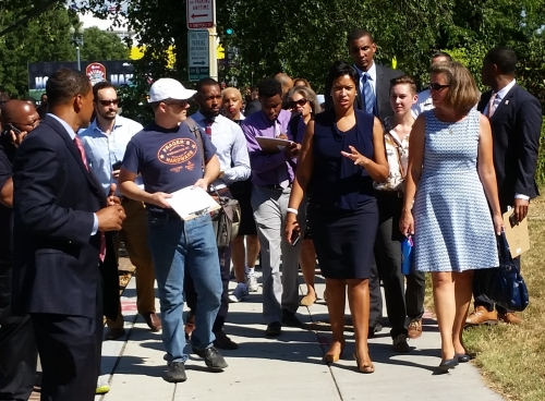 Mayor Bowser, flanked by ANC Commissioners Daniel Ridge and Denise Krepp on East Capitol Street Tuesday afternoon, enroute to Hill East's former Boys and Girls Club