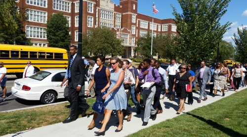The tour included a walk-by of Eastern High on East Capitol Street on the way to 15th and Independence, a focus of community concerns.