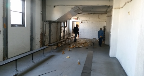 Headed through what was once maybe a locker room toward the basketball court on the south end of the building.