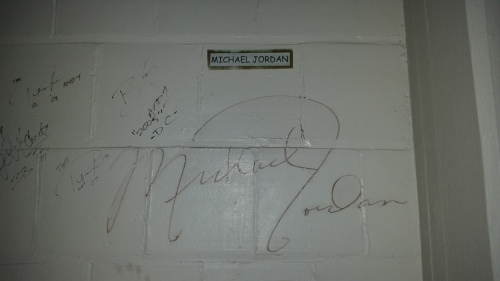 "Moving back to the south end of the building, an upper floor gallery wall displays the signatures of basketball greats Michael Jordan and Shaquile O'Neal...and actor Tom Cruise who filmed scenes for ""Minority report"" nearby,"