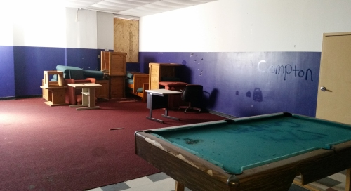 Upper floor, south side.  Pool table with pool balls long gone to a private collection.