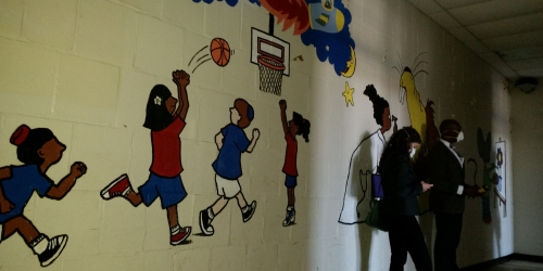 The wall opposite the famous autographs show one of several murals decorating the walls which speak to the former activities of the facility.