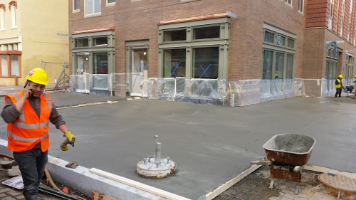 The Hine Project''s North Building got sidewalks last week, in a rush to complete the residential portion of the building by year's end.  Photo on December 23, 2016.
