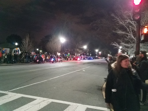 Monday night, circa 7:50pm, an orderly crowd protesting Trump's executive order banning Muslims confined itself to the sidewalks, encouraged by US Capitol Police on motorcycles, who circulated to keep the streets clear.